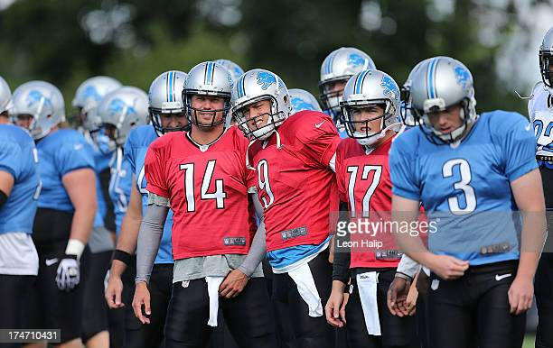 Quarterbacks Shaun Hill Matthew Stafford and Kellen Moore of the Detroit Lions get ready for the start of the daily drills during the third day of...