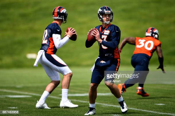 Quarterback's Trevor Siemian and Paxton Lynch of the Denver Broncos throwing during the first week of OTAs at the UCHealth Training Center May 23...