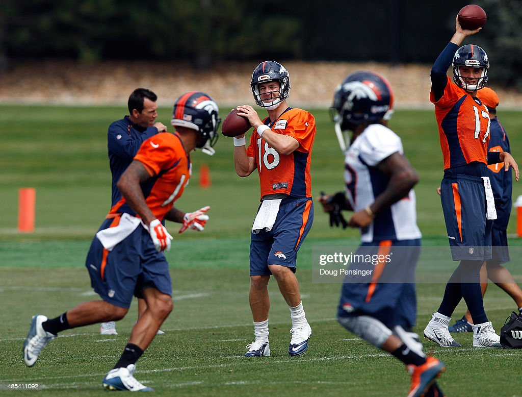 Quarterbacl Petyon Manning delivers a pass during a joint training session with the San Francisco 49ers and the Denver Broncos at the Denver Broncos...