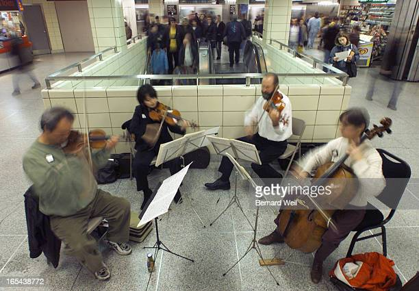A quartet of musicians from the Toronto Symphony performed for subway commuters at the southbound Yonge/Bloor station November 1 1999 Left to right...