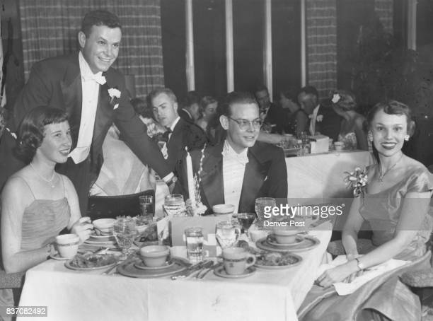 A quartet of partygoers who dined in the 18th floor barroom were Miss Cynthia Rippey Richard Catron Allan Hickerson and Miss Edith Davis Decorations...