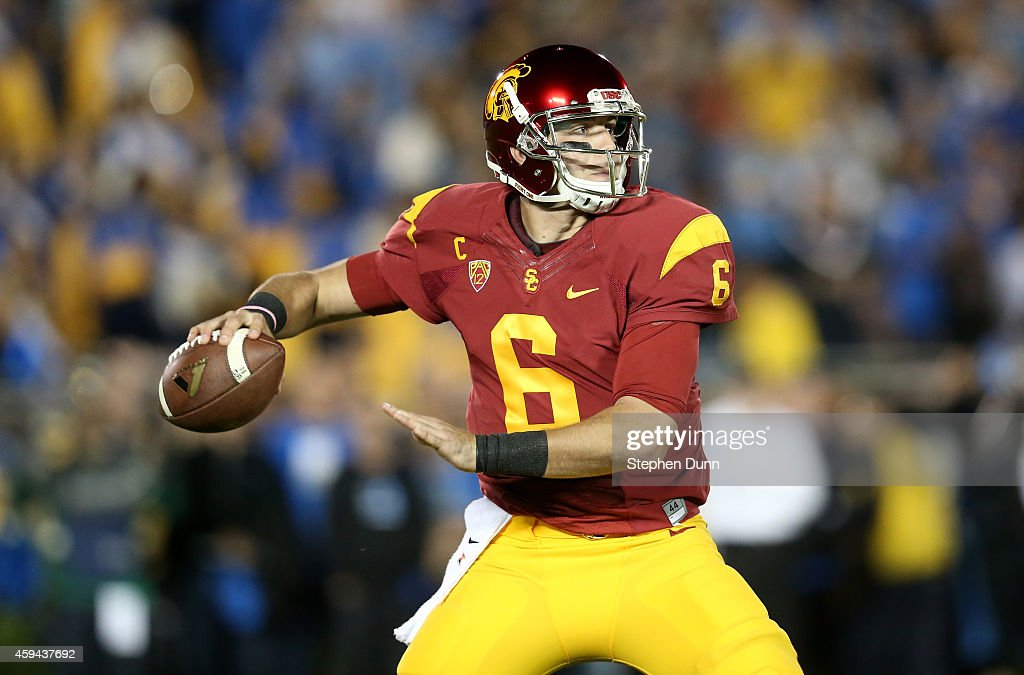Quartreback <a gi-track='captionPersonalityLinkClicked' href=/galleries/search?phrase=Cody+Kessler&family=editorial&specificpeople=9870723 ng-click='$event.stopPropagation()'>Cody Kessler</a> #6 of the USC Trojans throws a pass against the UCLA Bruins at the Rose Bowl on November 22, 2014 in Pasadena, California.