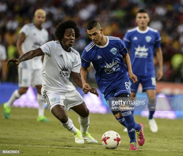 Quasim Bouy vies for the ball with Carlos Sanchez during a friendly match organized by the Juan Cuadrado foundation between the friends of Colombian...