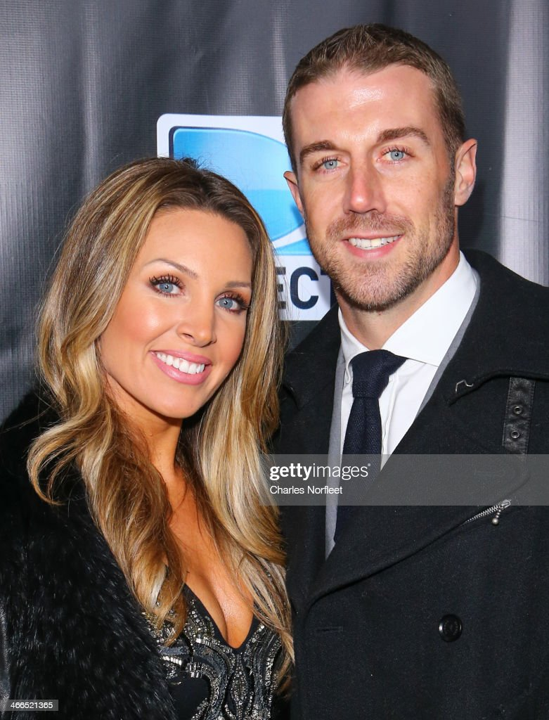 NFL quaterback Alex Smith (R) and his wife Elizabeth Barry attend the DirecTV Super Saturday Night at Pier 40 on February 1, 2014 in New York City.