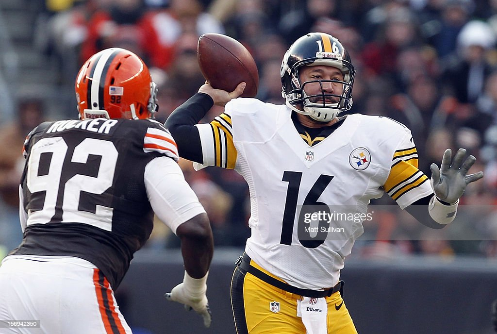 Quaterback Charlie Batch #16 of the Pittsburgh Steelers throws to a receiver as he is pressured by defensive lineman Frostee Rucker #92 of the Cleveland Browns at Cleveland Browns Stadium on November 25, 2012 in Cleveland, Ohio.