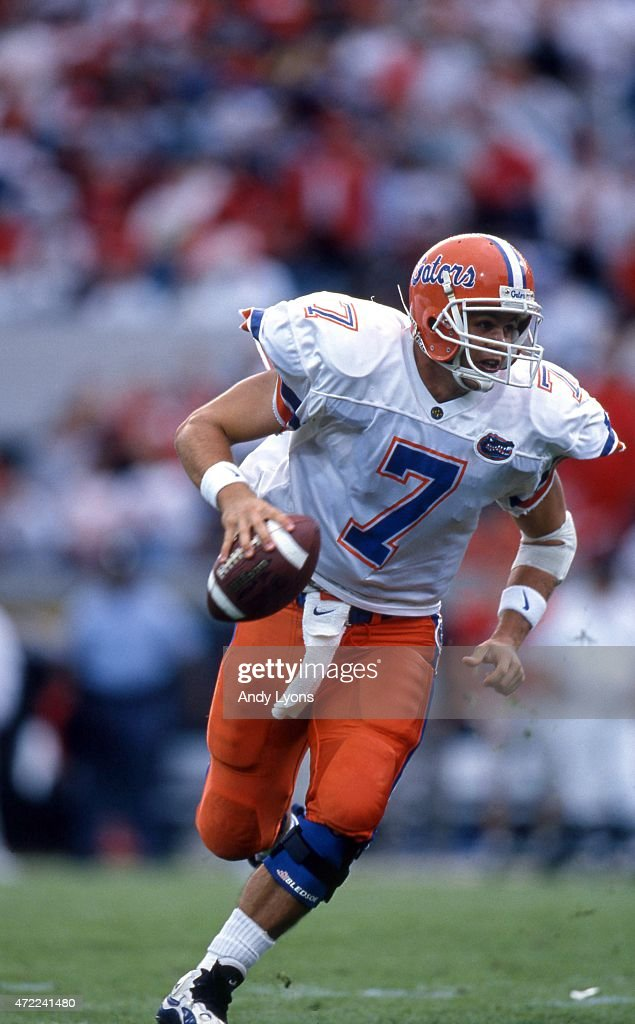 Quaterback Danny Wuerffel of the Florida Gators runs with the ball during an NCAA game against the Georgia Bulldogs on Novmeber 2 1996 at...