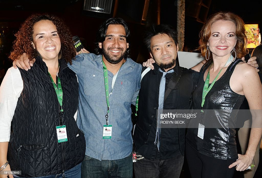 Quattro poses after receiving a nomination in the Best New Artist category at the announcement of nominations press conference for the 14th Annual Latin Grammy Awards, at the Avalon Hollywood, September 25, 2013 in Hollywood, California. The four members of Quattro are cellist Giovanna Clayton (L), percussionist Jorge Villanueva, (2L), guitarist Kay-Ta Matsuno and violinist Lisa Dondlinger (R). The music is either composed and/or arranged by members of the band.The Latin Grammys will take place on November 21 in Las Vegas. AFP PHOTO / Robyn Beck