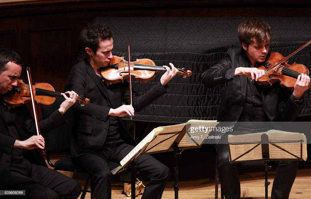Quatuor Ebene with Pierre Colombet on violin, Gabriel Le Magadure on violin and Adrien Boisseau on viola perform Franz Schubert's String Quintet in C major D956 at Wigmore Hall on April 28, 2016 in London, England.