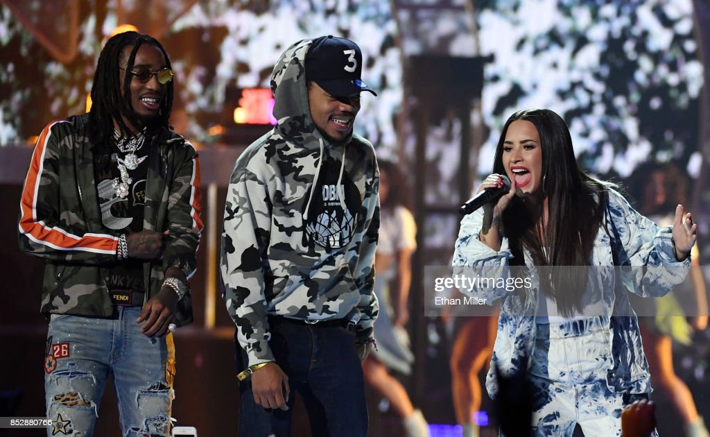 Quavo of Migos, Chance the Rapper and Demi Lovato perform during the 2017 iHeartRadio Music Festival at T-Mobile Arena on September 23, 2017 in Las Vegas, Nevada.