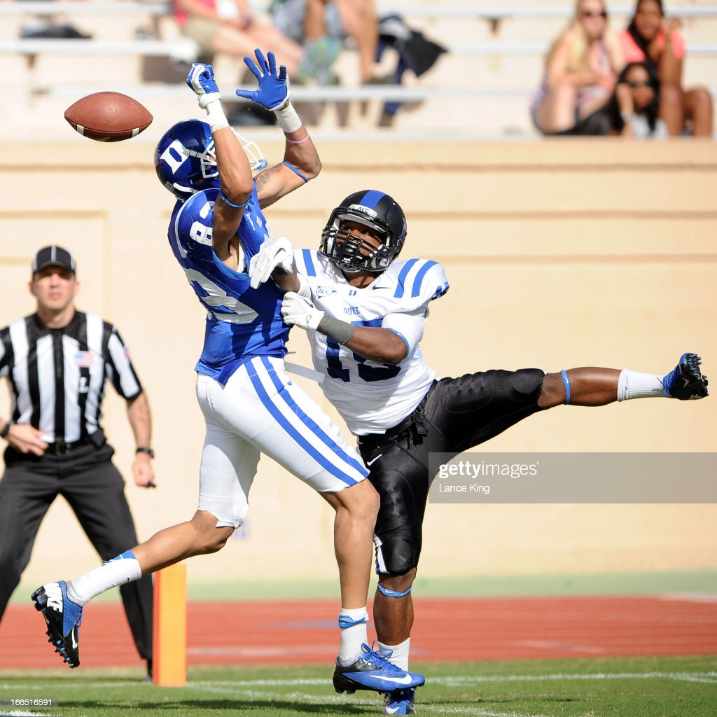 Quay Mann #15 breaks up a pass intended for Anthony Nash #83 of the Duke Blue Devils during their Spring Game at Wallace Wade Stadium on April 13, 2013 in Durham, North Carolina.
