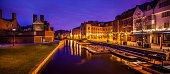 Early morning panoranic of historic Quayside river frontage with punt station in central Cambridge opposite Magdalene College