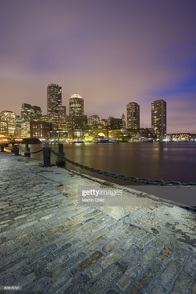 Quayside with skyline at night : Stock Photo