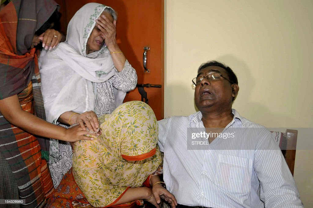 Quazi Mohammad Ahsanullah (R), the father of Bangladeshi national Quazi Mohammad Rezwanul Ahsan Nafis who arrested in New York for attempting to detonate a bomb, cries alongside other relatives in Dhaka on October 18, 2012. A Bangladeshi man with alleged al-Qaeda links was arrested October 17, 2012 in New York on charges of trying to use a 1,000 pound bomb to destroy the city's Federal Reserve building. Quazi Mohammad Rezwanul Ahsan Nafis, 21, was arrested in Manhattan after he tried to detonate what he thought was a live bomb, but was actually a dummy provided in a sting operation, federal prosecutors in Brooklyn said.