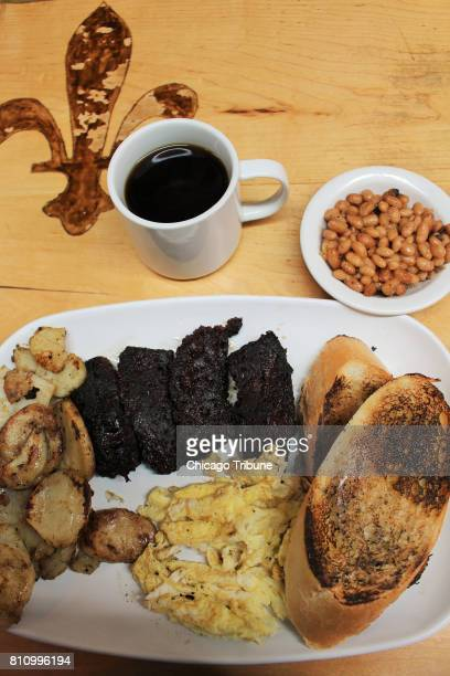 A Quebec breakfast at La Binerie MontRoyal features eggs boudin noir and the diner's specialty housebaked beans