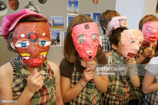 Quebec City art class students wear paper Mache masks