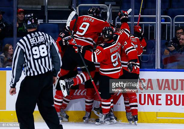 Quebec Remparts players celebrate after scoring the game tying goal late in the third period against the Baie Comeau Drakkar during their QMJHL...
