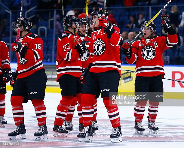 Quebec Remparts players celebrate their victory against the Baie Comeau Drakkar during their QMJHL hockey game at the Centre Videotron on October 14...