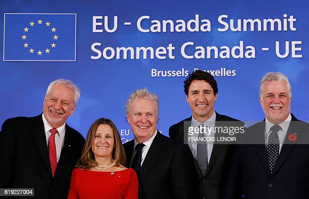 Quebec's former Premier PierreMarc Johnson Canada's International Trade Minister Chrystia Freeland Quebec's former Premier Jean Charest Canada's...