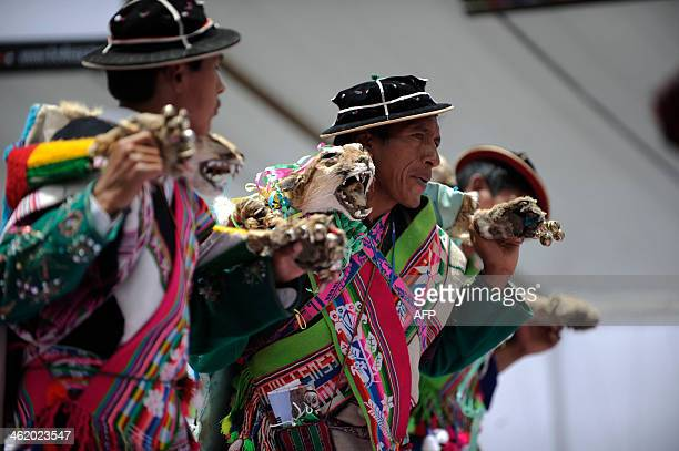 Quechua indigenous perform a traditional dance as they celebrate the arrival of motorcycles and quads during the 2014 Rally Dakar stage 7 in Uyuni...