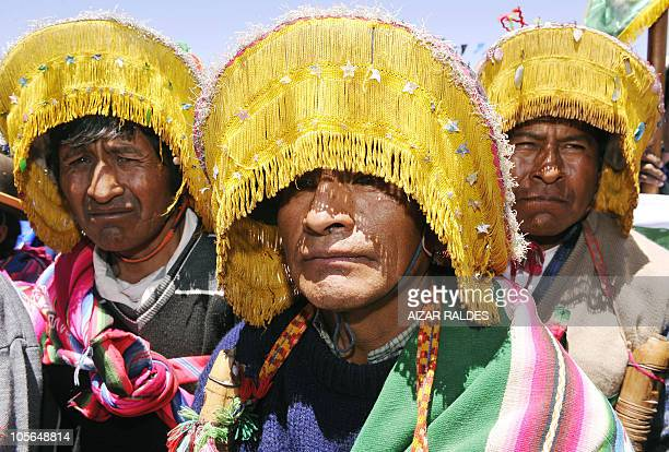 Quechua peasants wearing the attire of the indigenous people of Llica take part in a ceremony in Uyuni 550 km from La Paz October 17 2010 AFP...