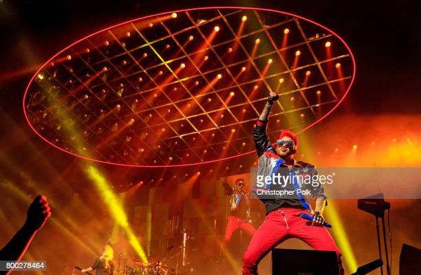 Queen and Adam Lambert perform onstage during the North American Tour kickoff at Gila River Arena on June 23 2017 in Glendale Arizona