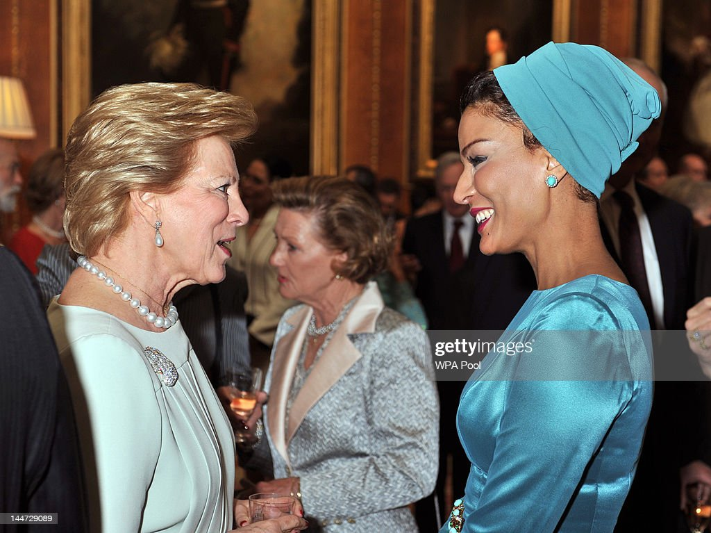 Queen Anne Marie of Greece talks with Sheikha Moza Bint Nasser Al-Missned during a reception in the Waterloo Chamber, before her Sovereign Monarch's Jubilee lunch, at Windsor Castle, on May 18, 2012 in Windsor, England.