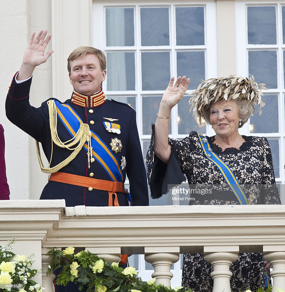 Queen Beatrix and Crown Prince Willem Alexander of The Netherlands wave from the Noordeinde Palace balcony after attending Budget Day announcement on September 18, 2012 in The Hague, Netherlands.