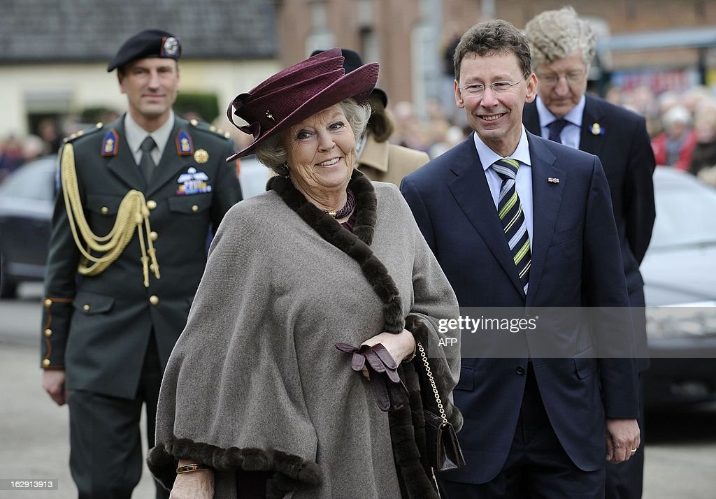 Queen Beatrix of Netherlands arrives with her commissioner Clemens Cornielje to visit the Rural Youth Union Gelderland in Tolbeek, on March 1, 2013, to mark the one century anniversary of the union. ANP / netherlands out