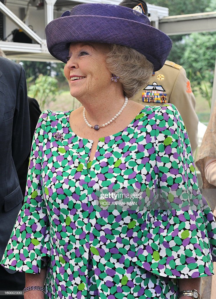 Queen Beatrix of Netherlands smiles at a water research facility during her visit to the NUS Van Kleef Centre, a water research facility renamed in honour of Karel Willem Benjamin van Kleef in Singapore on January 25, 2013. Queen Beatrix is on a three-day state visit in Singapaore.