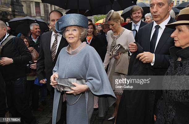 Queen Beatrix of the Netherlands accompanied by Prince WillemAlexander and Princess Maxima tours the historic city center with Saxony Governor...