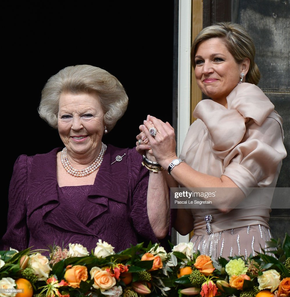 Queen <a gi-track='captionPersonalityLinkClicked' href=/galleries/search?phrase=Beatrix+of+the+Netherlands&family=editorial&specificpeople=92396 ng-click='$event.stopPropagation()'>Beatrix of the Netherlands</a> and Queen Maxima (R) appear on the balcony of the Royal Palace to greet the public after her abdication and ahead of the Inauguration of King Willem Alexander of The Netherlands on April 30, 2013 in Amsterdam, Netherlands.