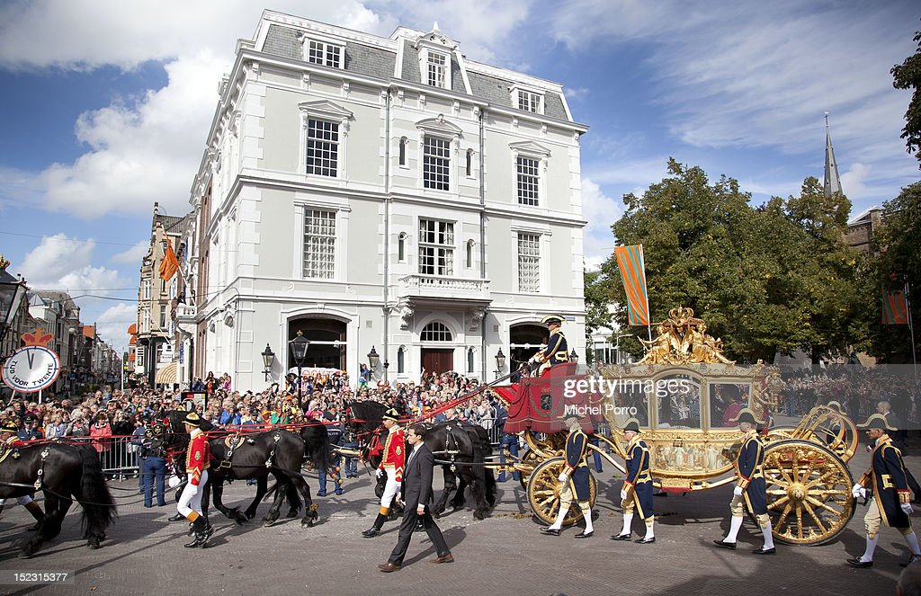 Queen Beatrix of the Netherlands, Crown Prince Willem Alexander and Princess Maxima of The Netherlands ride in the Golden Chariot after attending Budget Day announcement on September 18, 2012 in The Hague, Netherlands.