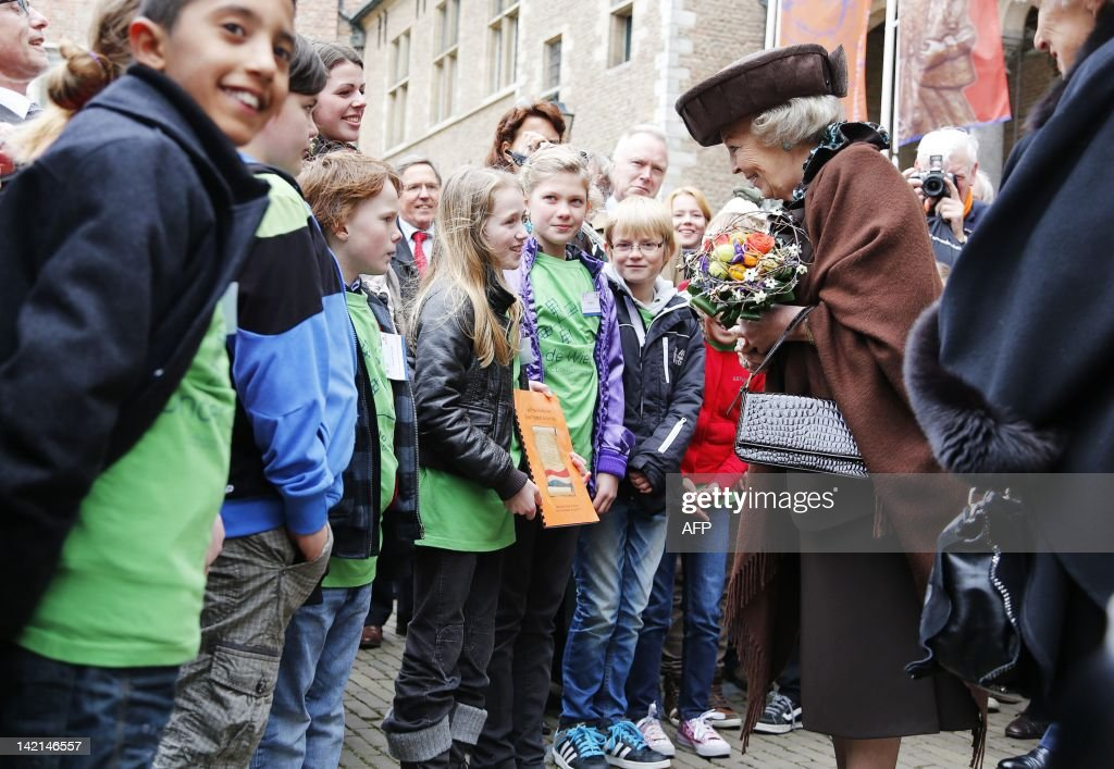 Queen Beatrix of the Netherlands greets children at the Zeeuws Museum as she inaugurates a new exhibition 'William of Orange: Ruler and diligence' in Middleburg on March 30, 2012. LAMPEN netherlands out