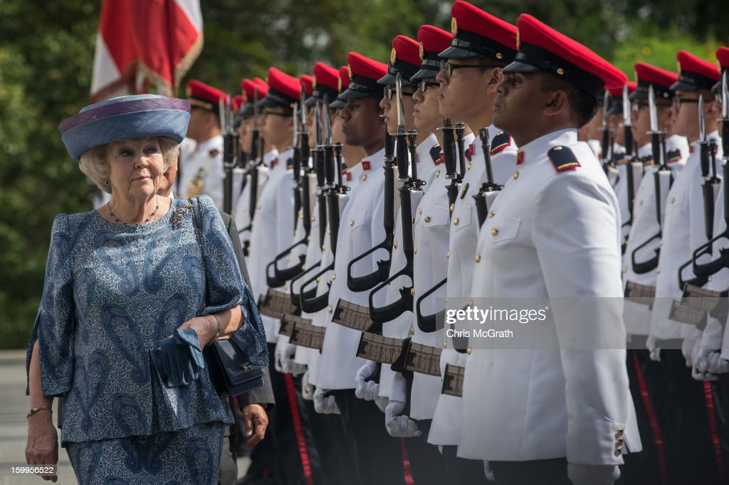 Queen <a gi-track='captionPersonalityLinkClicked' href=/galleries/search?phrase=Beatrix+of+the+Netherlands&family=editorial&specificpeople=92396 ng-click='$event.stopPropagation()'>Beatrix of the Netherlands</a> inspects the honour guard with Singapore President Tony Tan at the Istana on January 24, 2013 in Singapore. Queen Beatrix is on a three day state visit to Singapore.