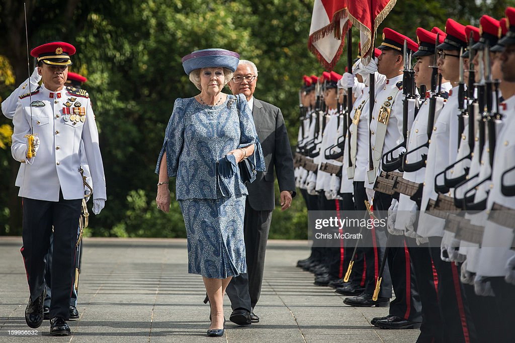 Queen Beatrix of the Netherlands inspects the honour guard with Singapore President Tony Tan at the Istana on January 24, 2013 in Singapore. Queen Beatrix is on a three day state visit to Singapore.