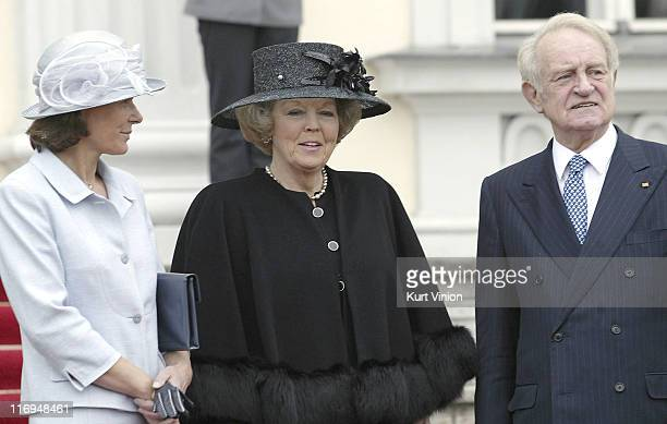 Queen Beatrix of the Netherlands is greeted by German President Johannes Rau and his wife Christina at Schloss Bellvue in Berlin on March 2004...