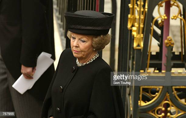 Queen Beatrix of the Netherlands leaves Westminster Abbey after the state funeral of the British Queen Mother April 9 2002 in London