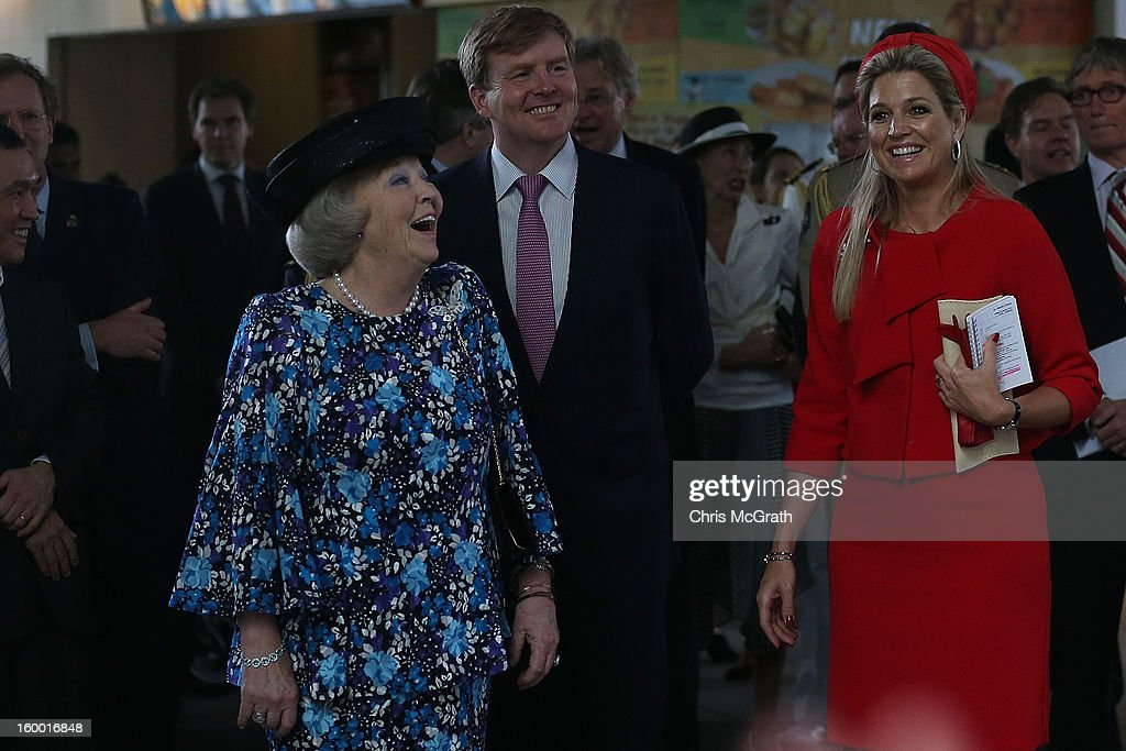 Queen Beatrix of the Netherlands, Prince Willem-Alexander and Princess Maxima react as dutch students from the Hollandse School sing a dutch song they toured the Singapore A*Star Fusionworld on January 25, 2013 in Singapore, Singapore. Queen Beatrix is on a three day state visit to Singapore.