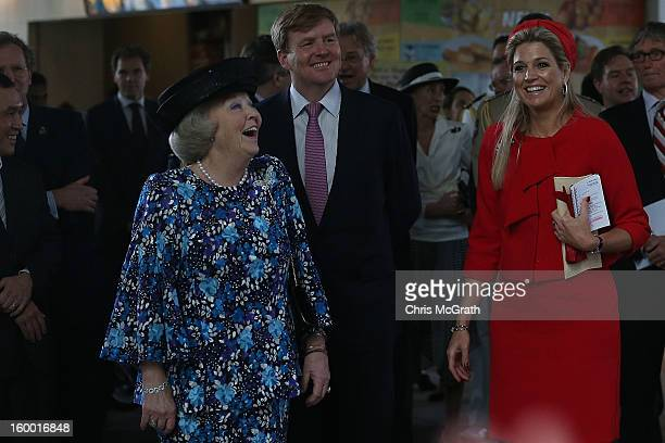 Queen Beatrix of the Netherlands Prince WillemAlexander and Princess Maxima react as dutch students from the Hollandse School sing a dutch song they...