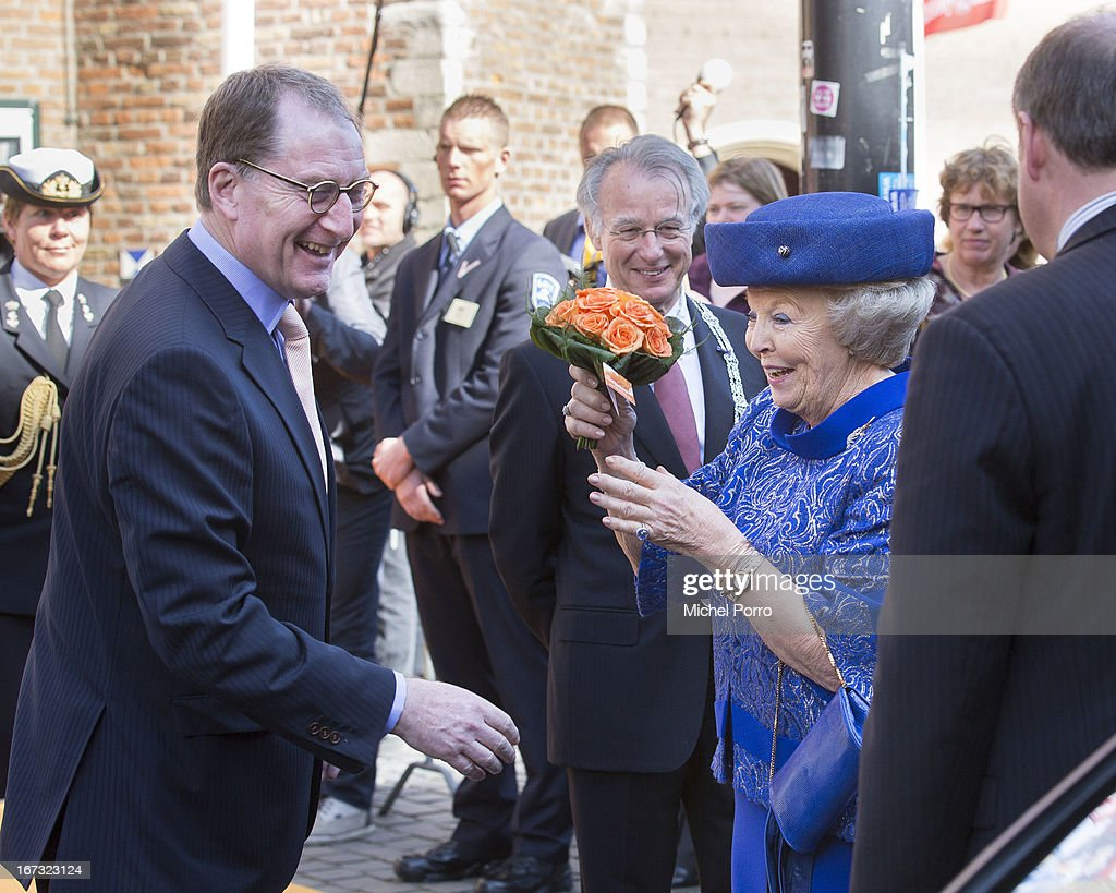Queen Beatrix of The Netherlands receives orange roses from a member of the public as she leaves after opening Huygens Exhibition in her last official engagement before her abdication on April 24, 2013 in The Hague, Netherlands.
