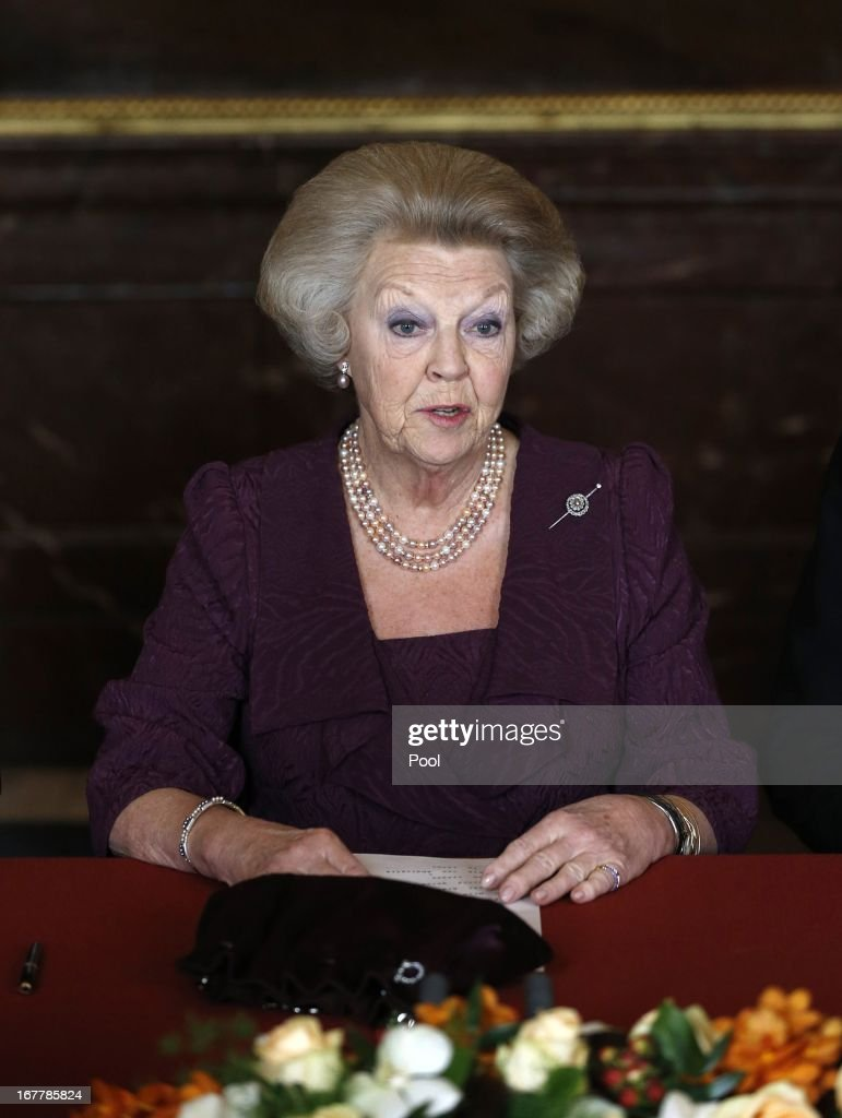 Queen Beatrix of the Netherlands signs the Act of Abdication during a ceremony in the Moseszaal at the Royal Palace on April 30 2013 in Amsterdam...