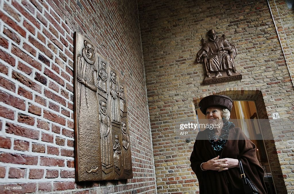Queen Beatrix of the Netherlands smiles after unveiling a plaque at the Zeeuws Museum as she inaugurates a new exhibition 'William of Orange: Ruler and diligence' in Middleburg on March 30, 2012. LAMPEN netherlands out