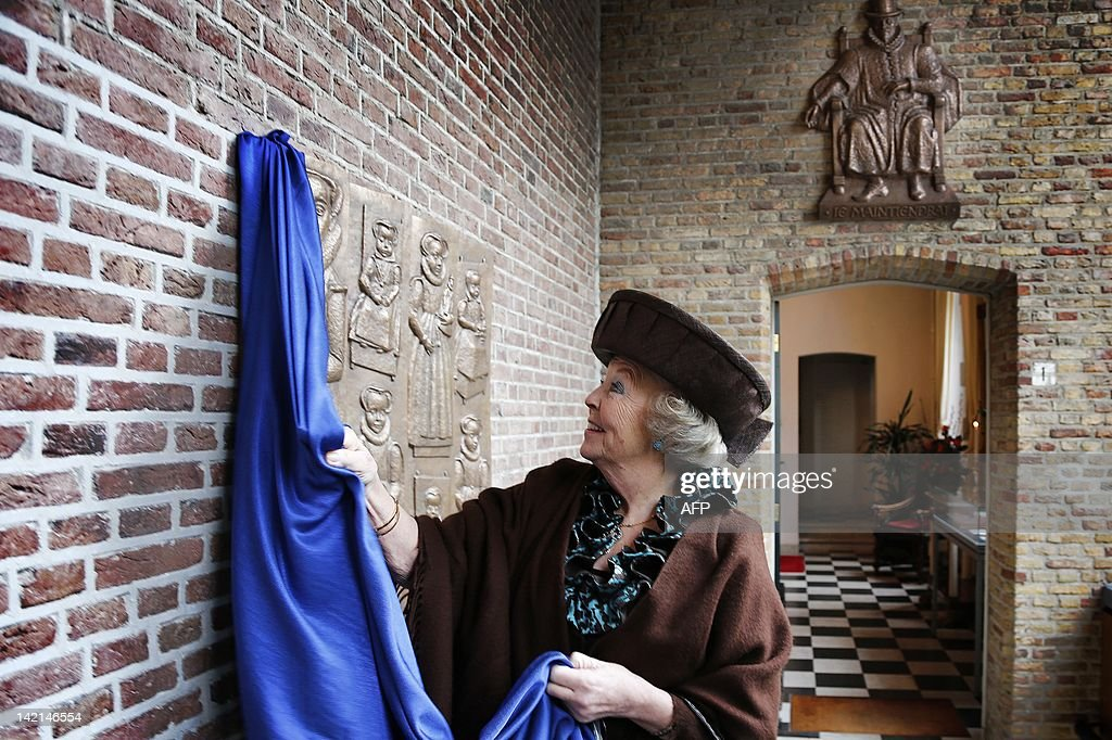 Queen Beatrix of the Netherlands smiles as she unveils a plaque at the Zeeuws Museum as she inaugurates a new exhibition 'William of Orange: Ruler and diligence' in Middleburg on March 30, 2012. LAMPEN netherlands out