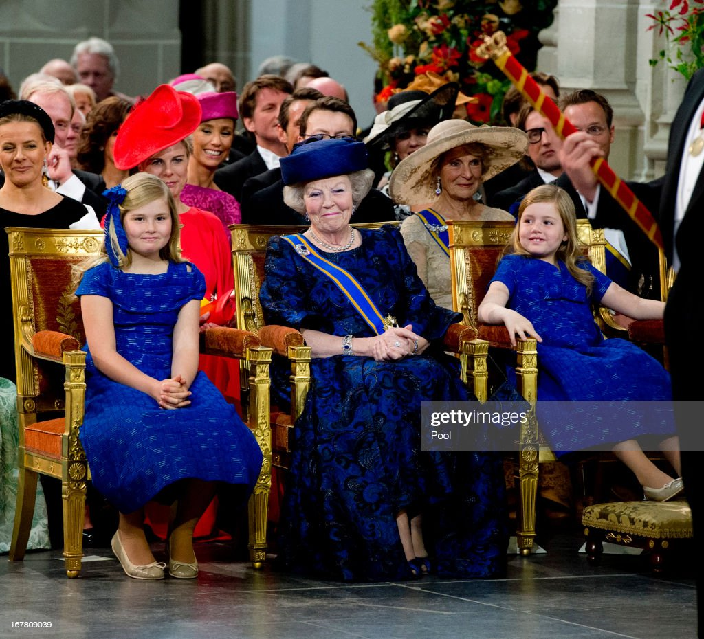 Queen Beatrix of The Netherlands stands with her granddaughters Princess Princess Alexia, Catharina Amalia and Princess Ariane during the inauguration ceremony of HM King Willem Alexander of the Netherlands and HM HRH Queen Maxima of the Netherlands at New Church on April 30, 2013 in Amsterdam, Netherlands.