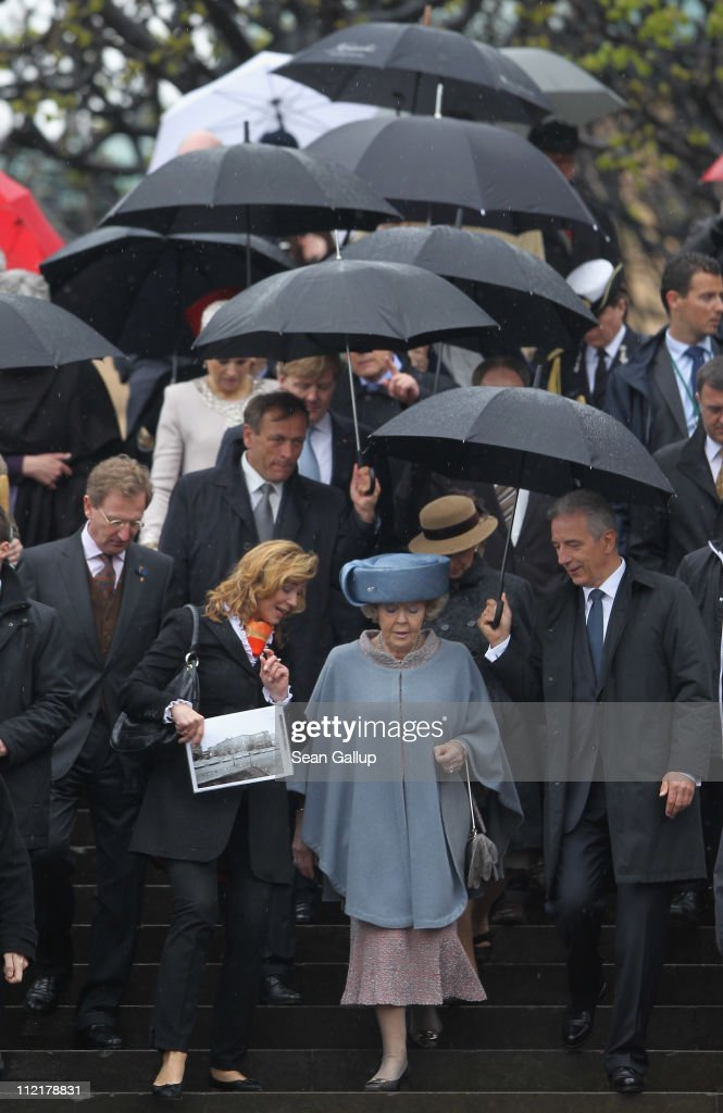 Queen <a gi-track='captionPersonalityLinkClicked' href=/galleries/search?phrase=Beatrix+of+the+Netherlands&family=editorial&specificpeople=92396 ng-click='$event.stopPropagation()'>Beatrix of the Netherlands</a> tours the historic city center with Saxony Governor Stanislaw Tillich (R) on April 14, 2011 in Dresden, Germany. The Dutch royals, including Prince Willem-Alexander and Princess Maxima, are on a four-day visit to Germany that includes stops in Berlin, Dresden and Duesseldorf.