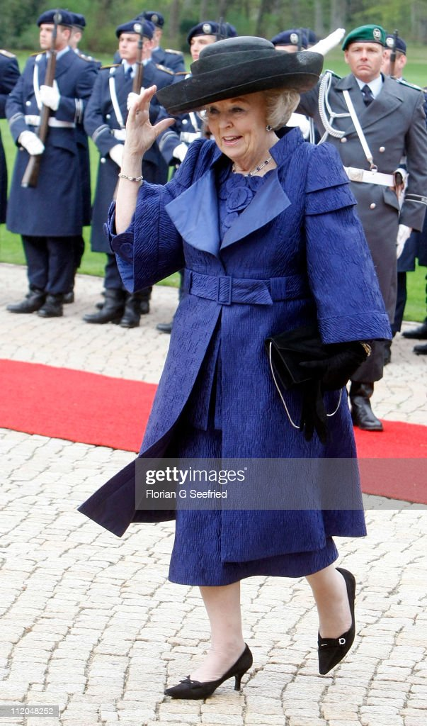 Queen Beatrix of the Netherlands walks past a guard of honor at Bellevue Presidential Palace on April 12, 2011 in Berlin, Germany. The Dutch royals are on a four day visit to Germany that includes stops in Berlin, Dresden and Duesseldorf.