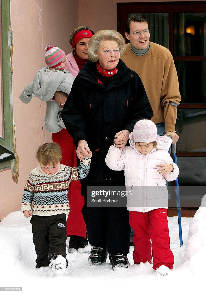 Queen Beatrix (C) of the Netherlands walks with Count of Orange Claus-Casimir (L) and Countess of Orange Eloise (R) as Princess Laurentien holds Countess of Orange Leonore while she walks with Prince Constantijn at the start of their annual Austrian skiing holiday on February 11, 2006 in Lech, Austria.