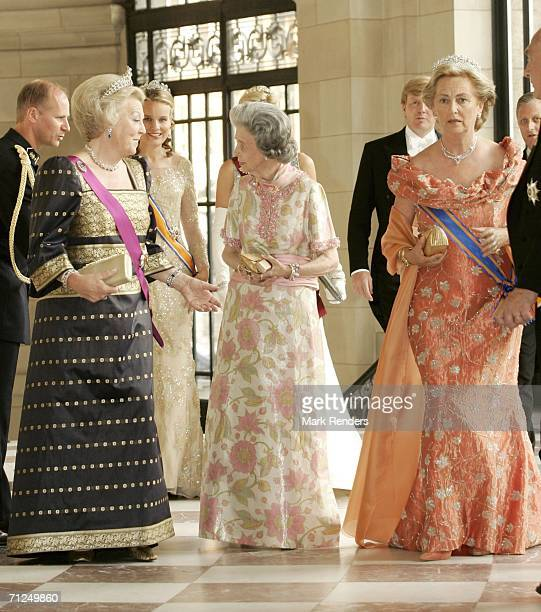 Queen Beatrix Queen Fabiola and Queen Paola stand together at Laken Castle before the gala dinner as part of the 3day visit of Queen Beatrix to...