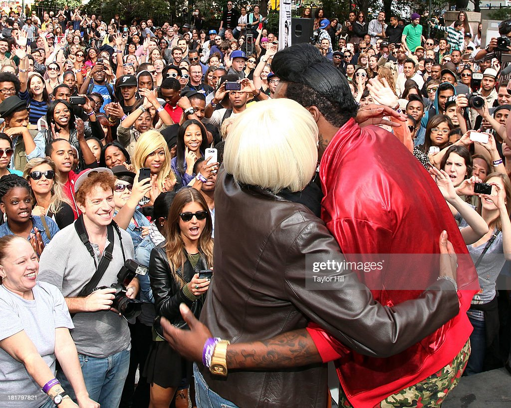 Queen diva <a gi-track='captionPersonalityLinkClicked' href=/galleries/search?phrase=Big+Freedia&family=editorial&specificpeople=7263232 ng-click='$event.stopPropagation()'>Big Freedia</a> hugs his mother after breaking the Guinness World Record for twerking at Herald Square on September 25, 2013 in New York City.