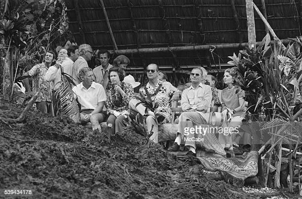 Queen Elizabeth and Prince Philip watching a display of landdiving from a bamboo tower during their visit to Pentecost Island Vanuatu off the...